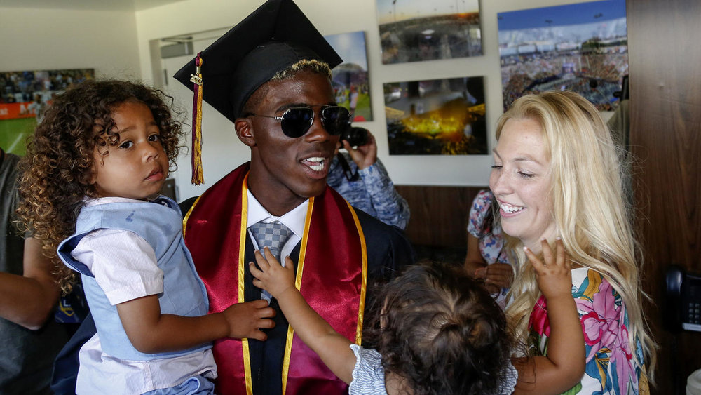 Mark Boster / Los Angeles Times  Galaxy soccer star Gyasi Zardes celebrates with his wife, Madie, and children, Gyan and Maylie, after graduating from Cal State Dominguez Hills.