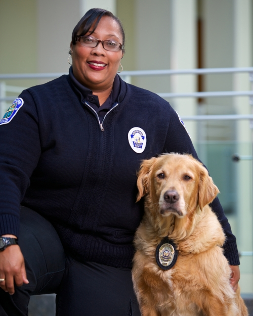 HPD Police Service Officer Bell and Scottie.  She takes care of Scottie 24/7.  Photo by Erick Chavez