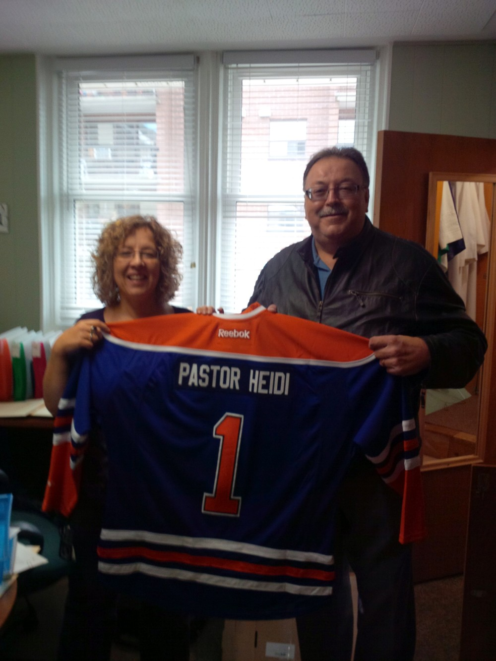 Karl Kiefer, a member of the church council, presented Pastor Heidi with her very own Edmonton Oilers jersey with her name stitched on it.
