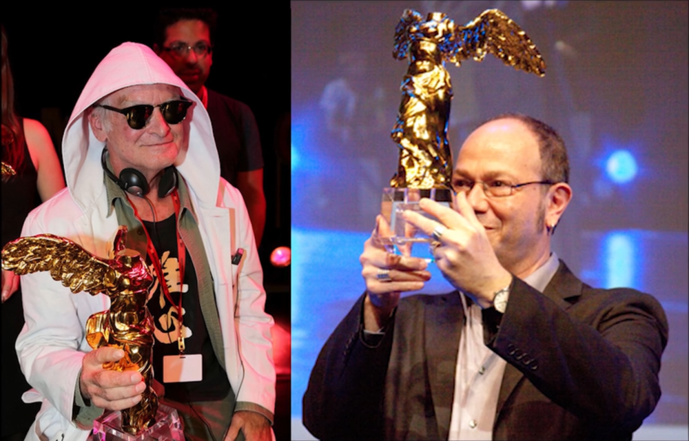 Joe Davis (left) winning the ars electronica golden nica award in 2012 for bacterial radio. Eduardo Kac (right) winning the same award in 2008 for natural history of the enigma
