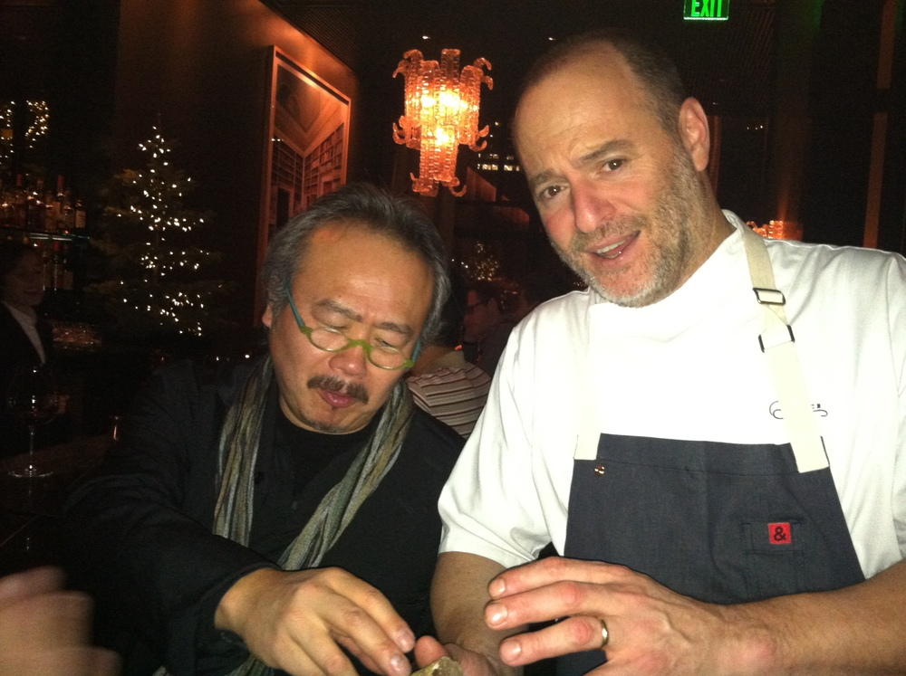 Hiro Sone tries in vain to swipe Michael Tusk's white truffle