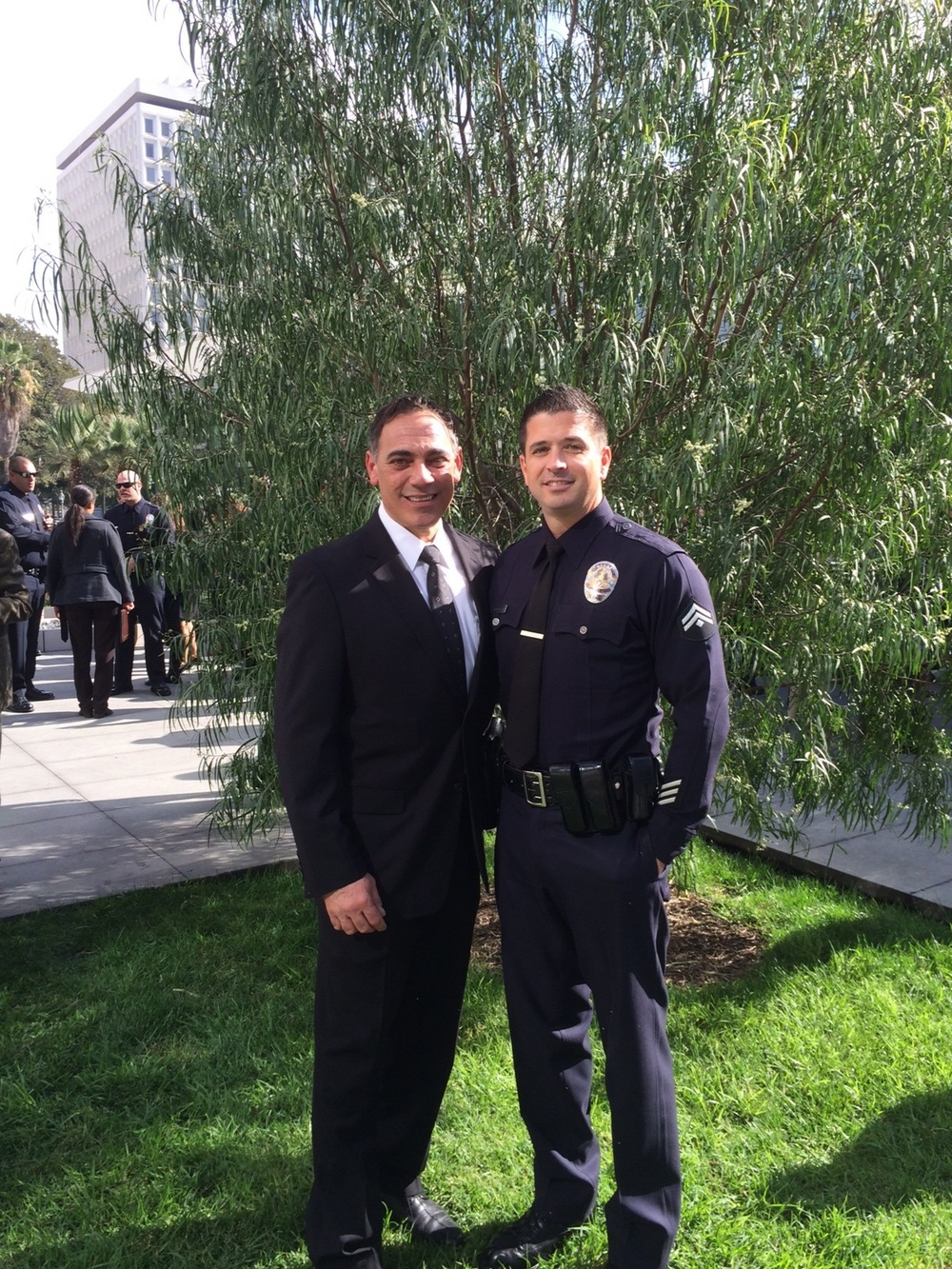 Det. Sam Marullo, in uniform, with Det. Sal LaBarbera