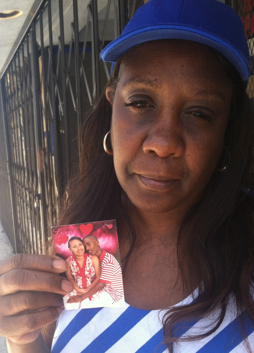 Janet Sanders Bolden holds photo of her slain son Aveion and his girlfriend Jacinta, killed Friday on Figueroa and 87th.
