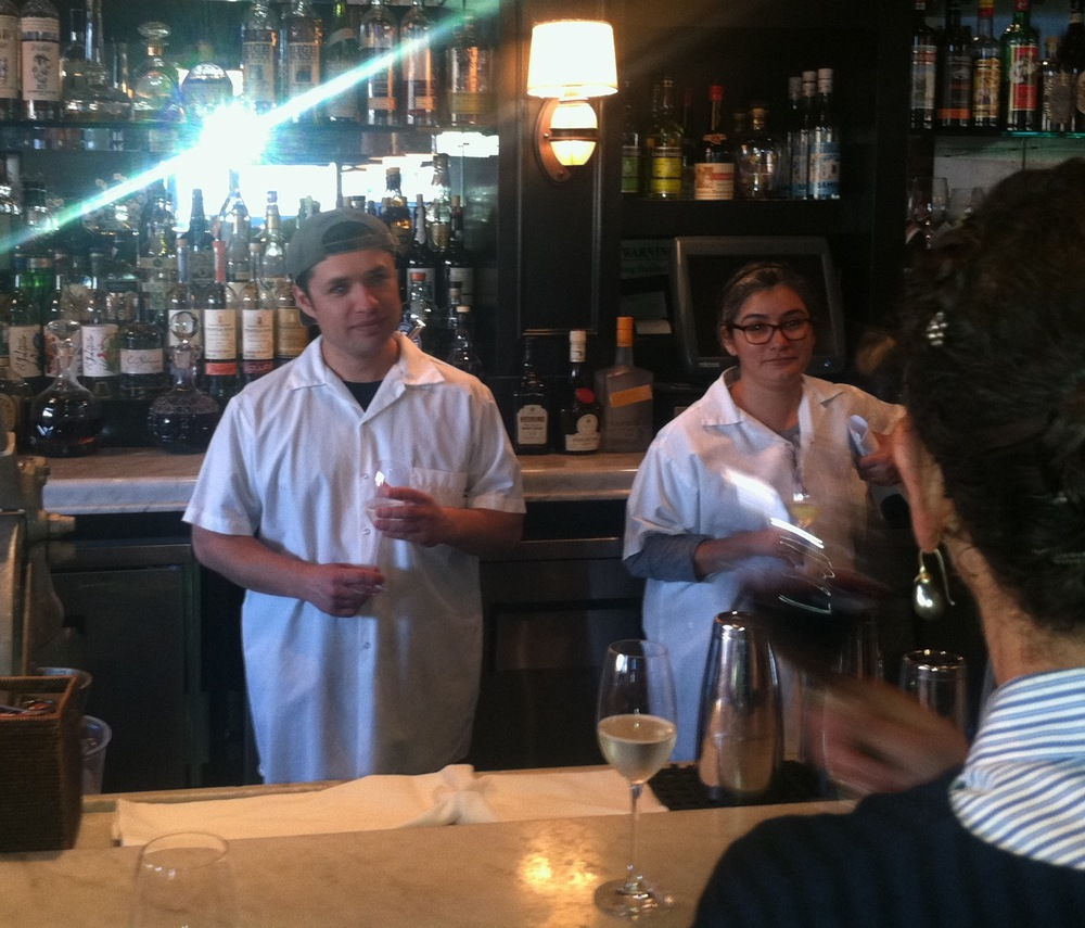 "AFter his farewell ""lineup"" talk, Matt Molina listens as Nancy Silverton toasts his mozza career. Pastry chef Dahlia Narvaez Looks on"