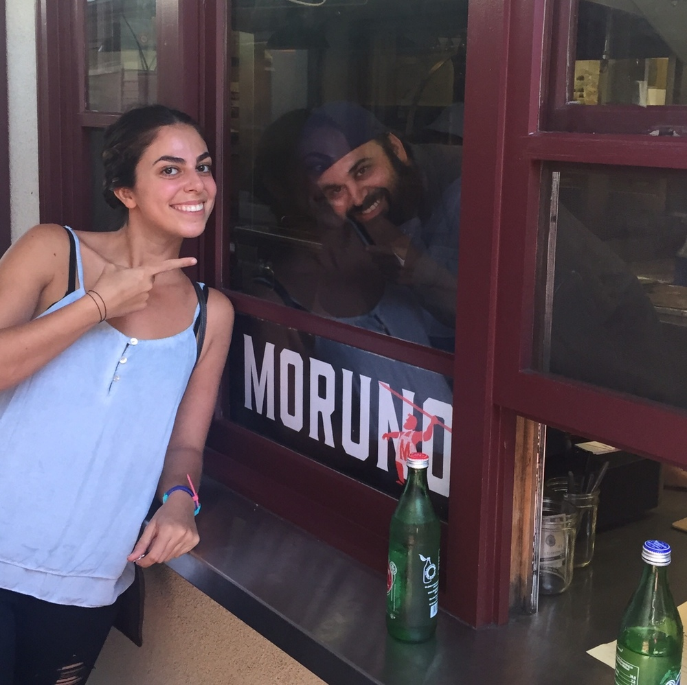 Deb michail A happy customer, points to moruno chef chris feldmeier