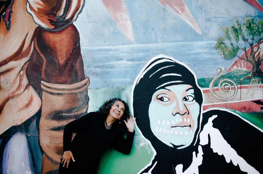 """Mexican-American artist Lilia Gracia Castro communing with art. Her retrospective, """"A Contemporary View of Pre-Hispanic Art,"""" spanning 30 years of work between San Diego and Mexico City, was featured this summer at the Centro Cultural de la Raza. San Diego, 2013"""