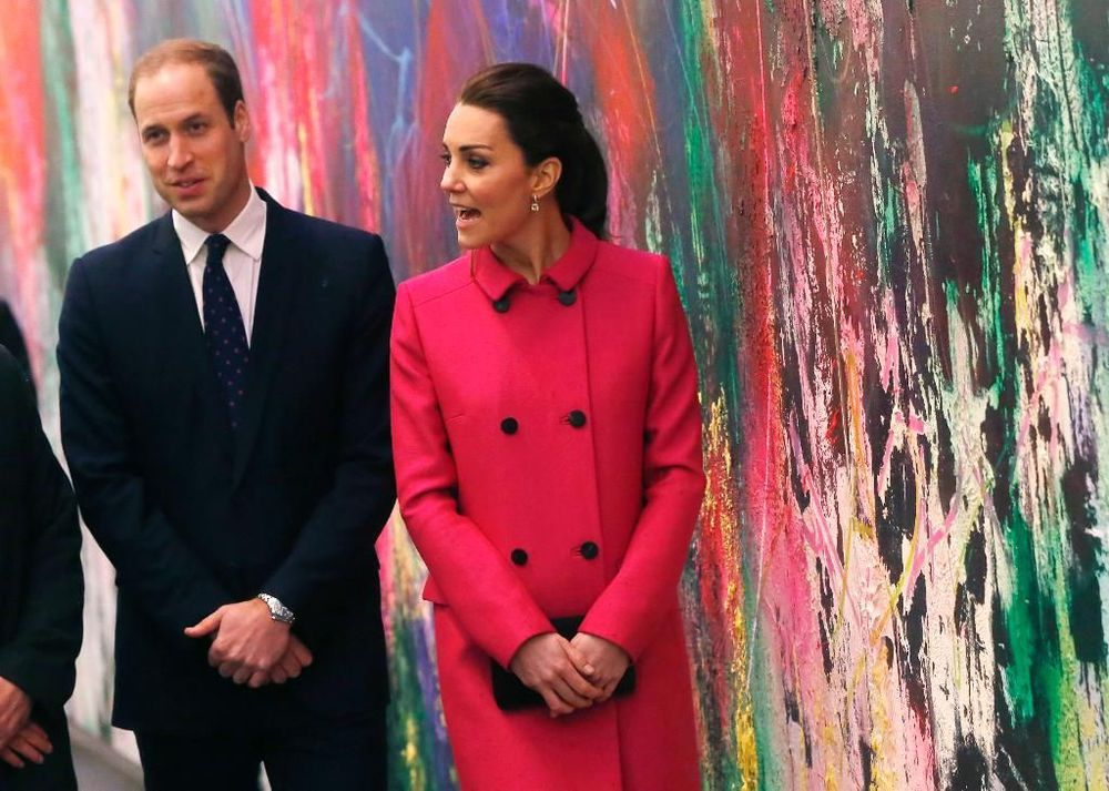 In this Dec. 9, 2014 file photo, Britain's Prince William, Duke of Cambridge, left, and Kate, Duchess of Cambridge, walk in front of a mural by Jose Parla as the royal couple takes a tour of the lobby of new One World Trade Center following a visit to the nearby National September 11 Memorial and Museum, in New York. The building opened to great fanfare last month as the first tenants moved into the 104-story tower through the vast lobby dominated by Parla's monumental abstract mural. The color-splashed, 90-by-15-foot painting is among 13 public artworks by five artists selected or commissioned for the historic skyscraper. (AP Photo/Shannon Stapleton, Pool, File)
