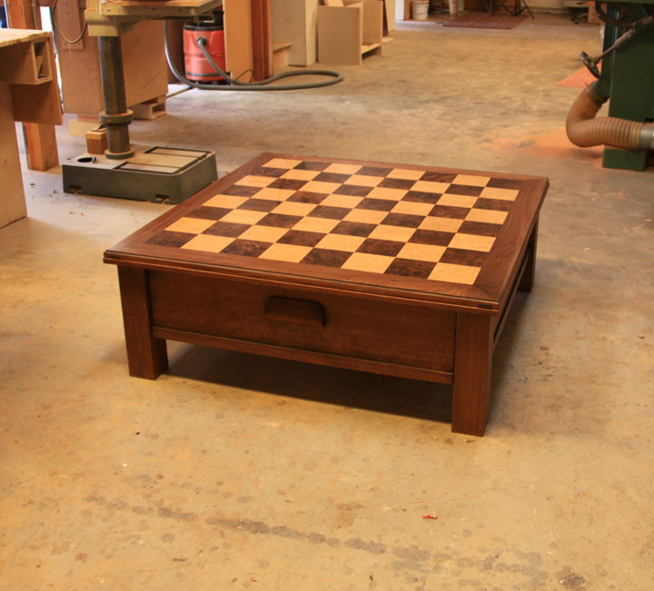 Reversible top chess table with Oak and walnut veneers. Designed by Michael Wunderle.