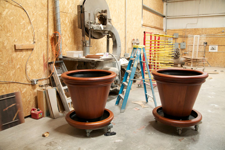 Custom Mahogany planters with fiberglass and stainless steel linings.