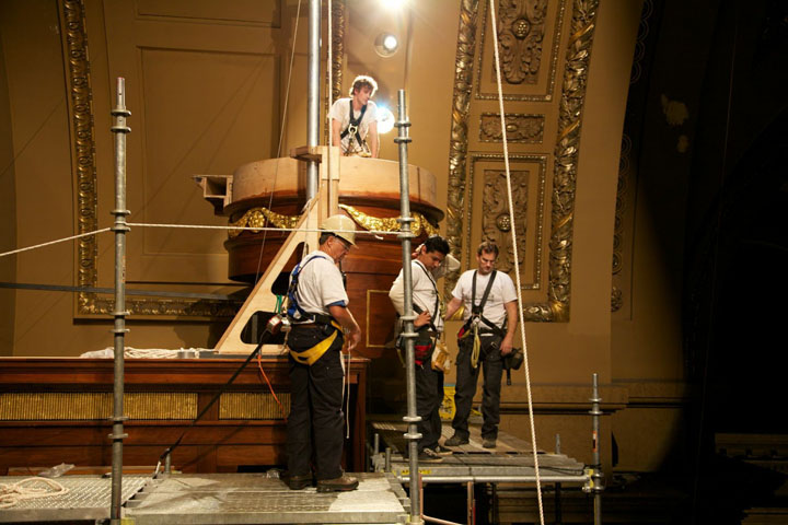 Preparing to lift an upper entablature.
