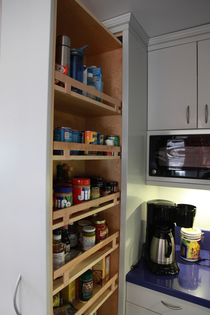 Pull-out pantries with 450lb. load capacity. We always use high quality, durable hardware in our kitchens.