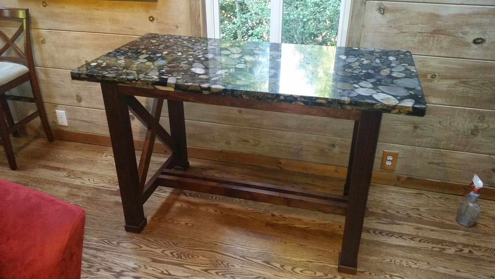Completed table in Walnut with full mortise and tenon construction and custom Granite top.