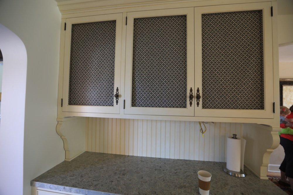 Bronze screen cabinet doors.
