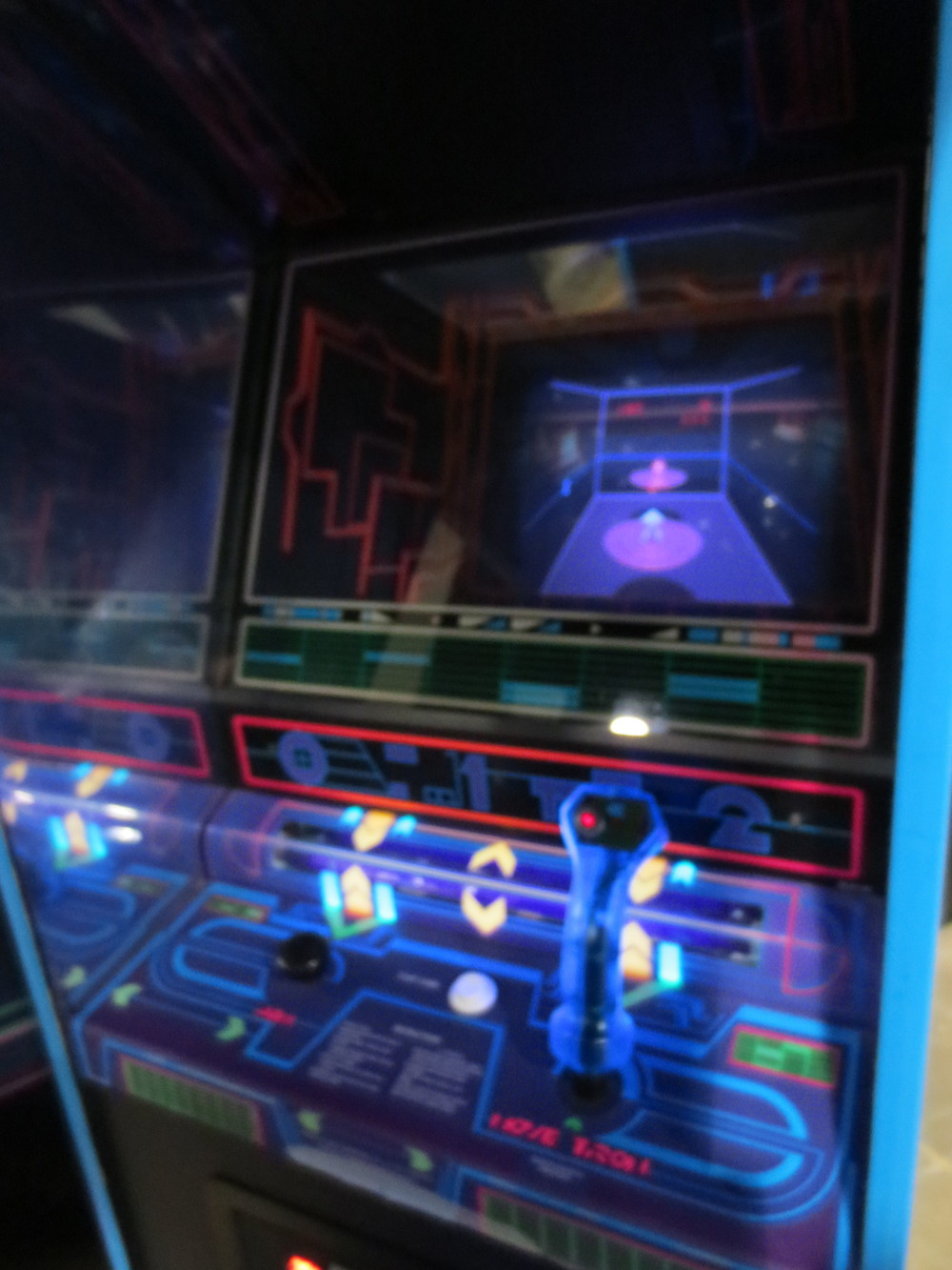 The Tron arcade game. Ultra fun and super sleek-looking.