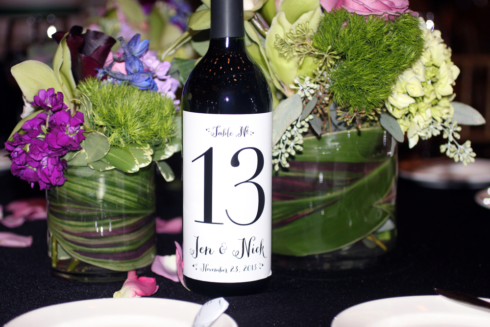 Personalized wine bottle labels for table numbers by The Charm Studio