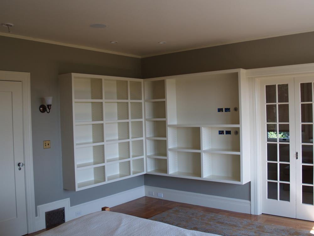 Custom shelving for storage and entertainment center
