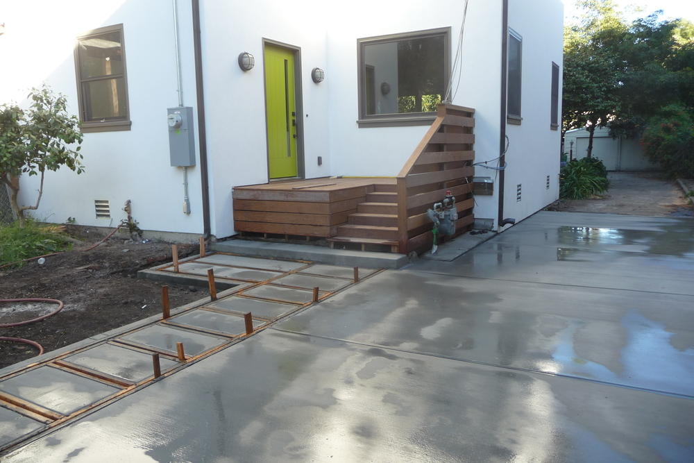 A new driveway with concrete steps that will have a green border around them.  Complete photos of the finished project will be up soon.