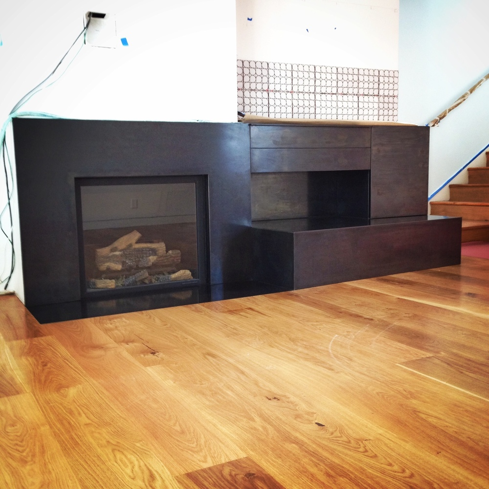 Steel Entertainment center and Fireplace