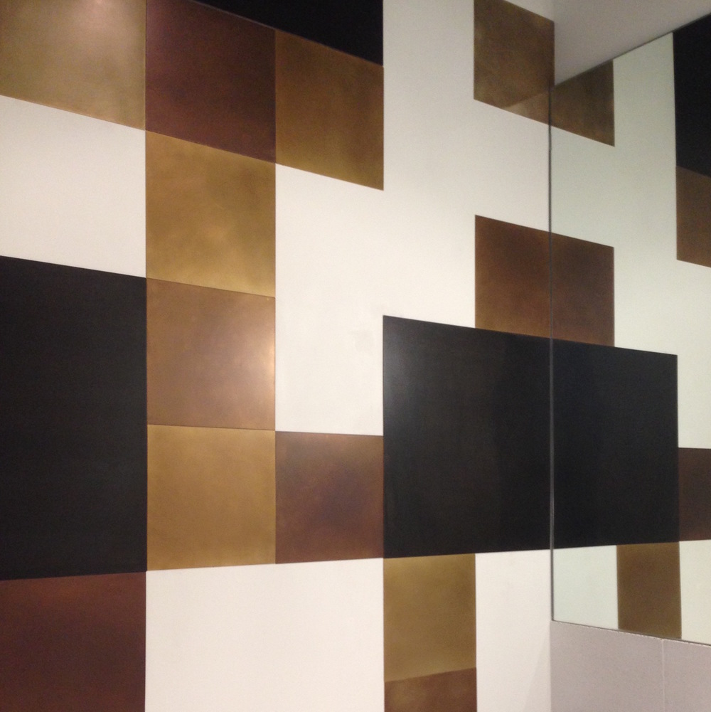 Patinated brass tile wall