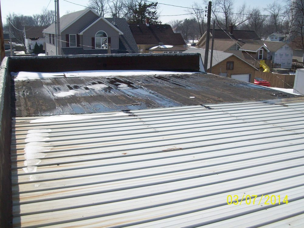 Before Picture - Mod. Bit. & Metal Roofing