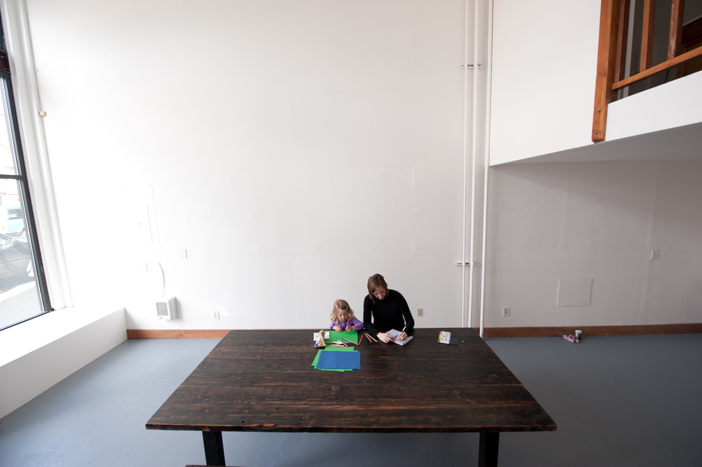 My daughter and I in an empty TPR before opening in 2011, thinking about what we should do in there (she was more likely drawing some animals)