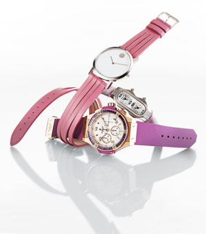 Sweet Tock | A fresh crop of watches catches the wave of the fuchsia. Once reserved for Swatch-wearing teens circa 1985, splashy pink and purple watches can now be spotted on posh and sporty adult wrists too. Movado sweetens its double-wrap offering with a sliced band in bubblegum pink. Ideal for the fun-loving gal on the go, the scored leather strap adds a youthful twist to the house's spare signature dial. Hublot and Philip Stein prefer to juxtapose extravagance with practicality. The former sets a milky face encircled by rectangular amethysts against a sturdy rubber band topped with chunky gold bits. The latter couples satin and diamonds in a slim and trim evening timepiece that features dual time zones. Now that's two-timing of the best kind. From top: Movado's stainless steel watch,Philip Stein's stainless steel and diamond watch, Hublot's 18k red gold and amethyst watch.