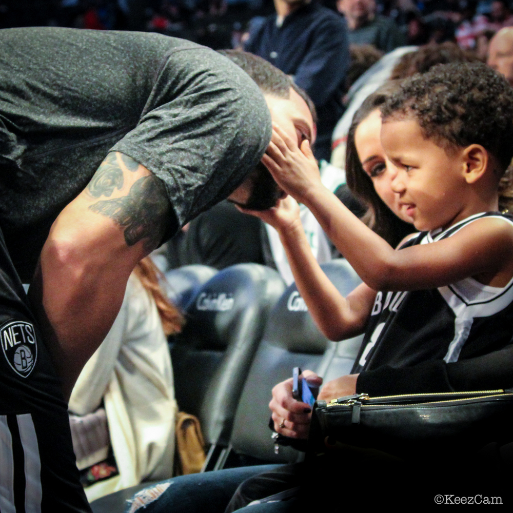 The connection of a father & son courtside in Brooklyn