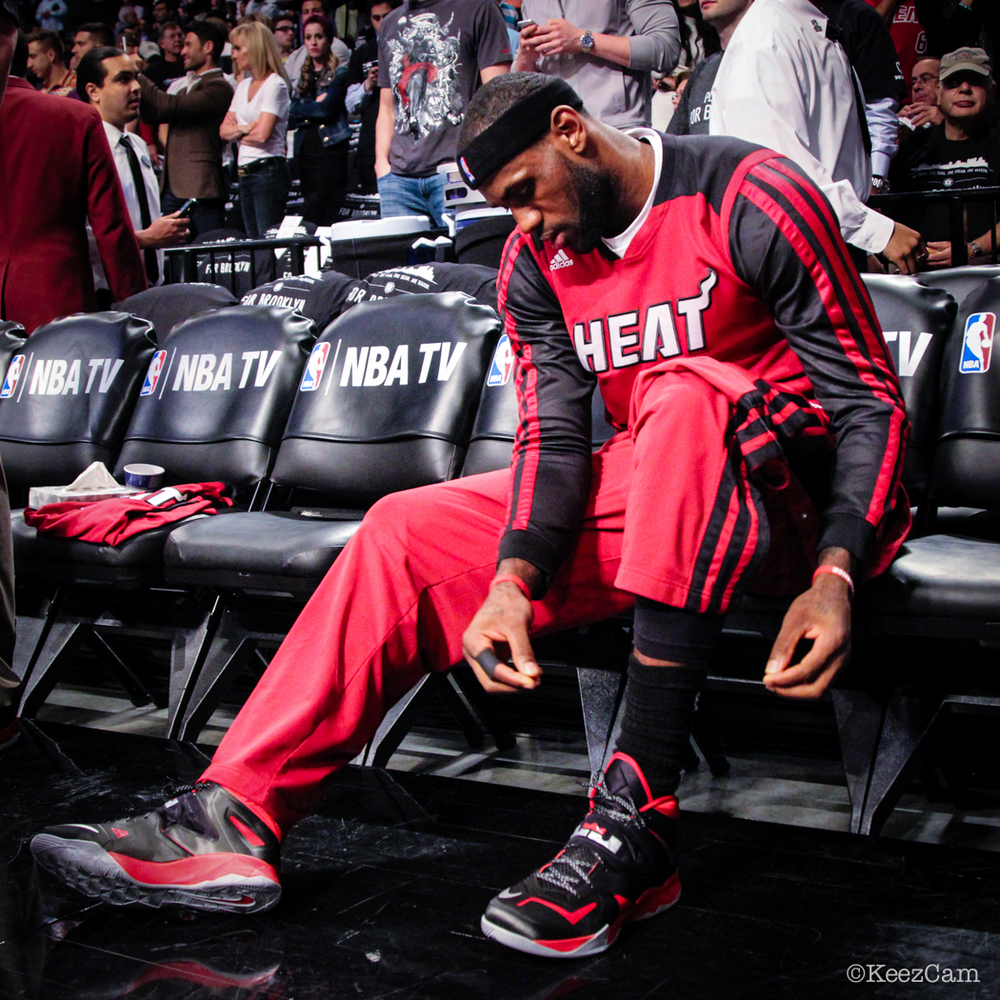 LeBron James lacing up the Game 4 Kicks.