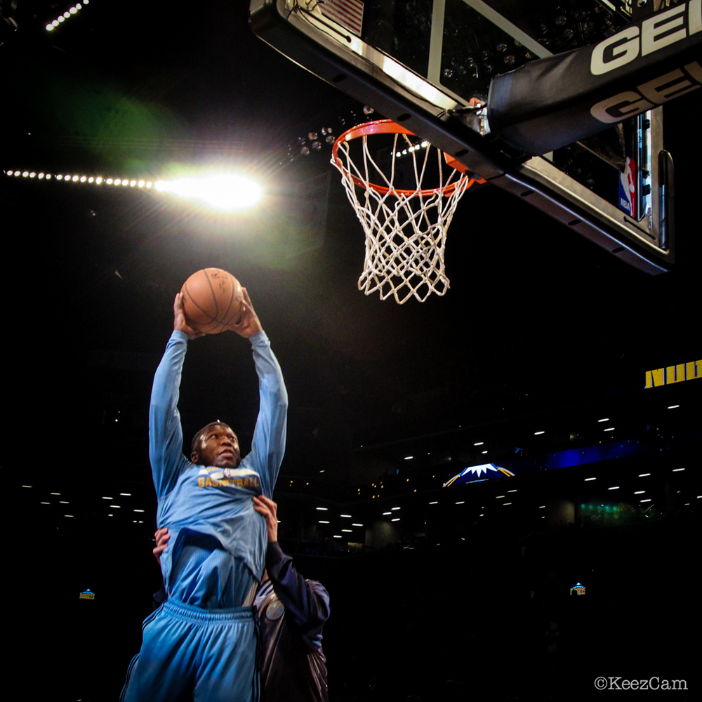 Denver Nuggets G Nate Robinson about to rock the rim with a little help from Denver Nuggets C Jusuf Nurkic