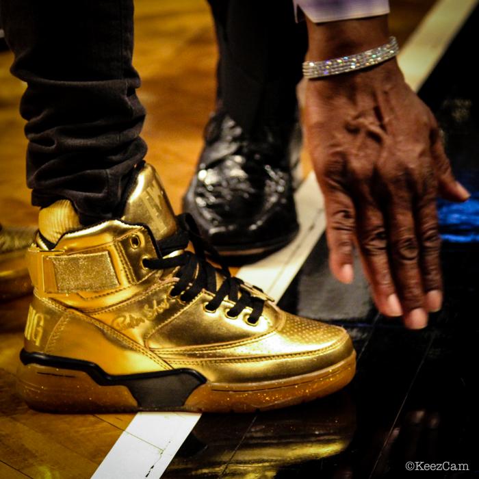 Patrick Ewing's hand swiping Teyana Taylor shoe