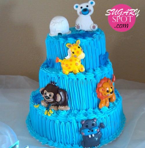 pastel decorado con figuras modeladas a mano de precious planet