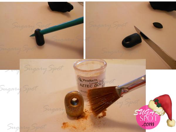 4.- Haz un rollito de pasta de chocolate color negro, perforala de un extremo y córtala del otro. Con ayuda de un pincel o brochita aplica Lustre color Oro.