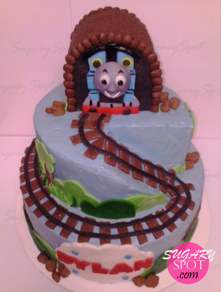 Thomas the train. Cake iced w/ buttercream, decorations made of modeling chocolate.