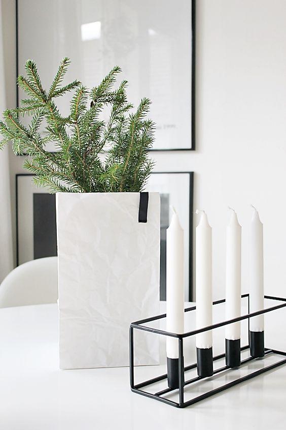 Yksinkertaisimmillaan joulua voi tuoda moderniin kotiin metsästä poimituilla havunoksilla. Kuva: Pinterest