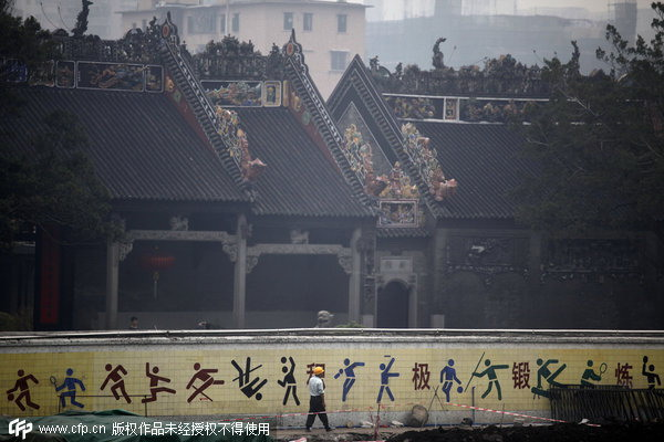 Chenjiaci, an ancestral temple in Guangdong province's Guangzhou, is demolished in 2010. The building, which cost 800 million yuan ($130 million) to construct, was torn down after being in use for only four years and replaced by a subway station.