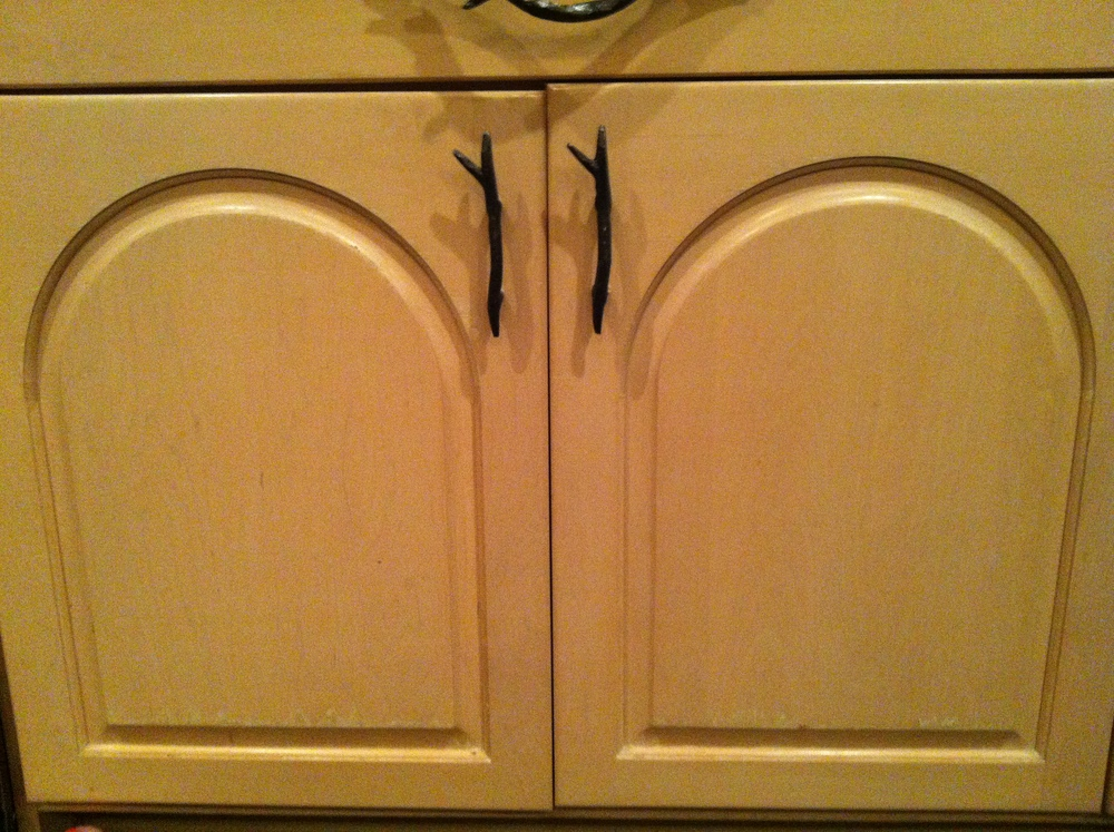 Blonde Wood Kitchen Cabinets with Twig Door Handles.JPG