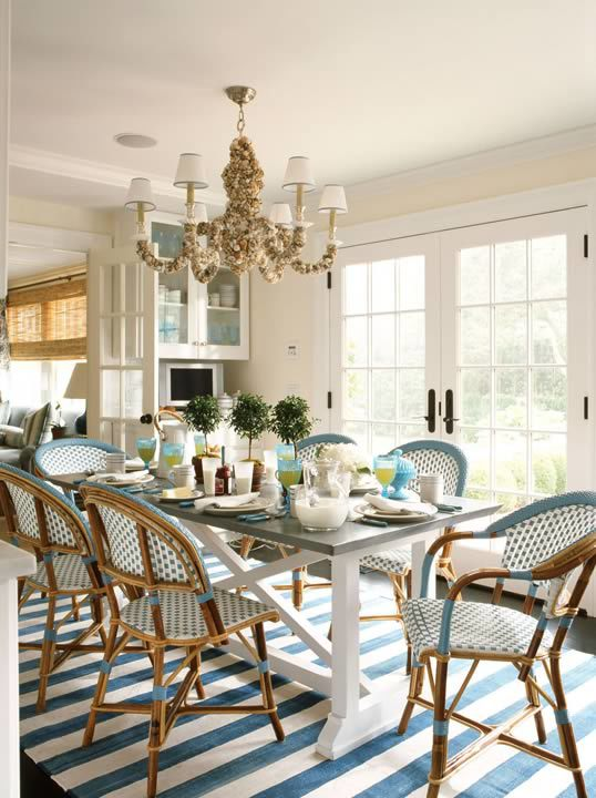 ashley-whittaker-design-breakfast-dining-room-south-hampton-summer-home-farm-table-french-bistro-chairs-blue-white-sea-shell-six-light-chandelier-french-doors-striped-ruge-carpet.jpg