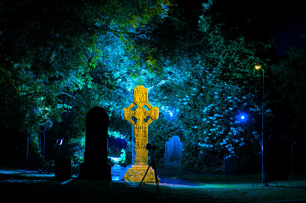 "A ""behind the scenes"" photo showing some of the lighting setup around The South Cross, a 9th Century high cross inside St. Columba's Church ground, Kells, Co. Meath, Ireland."