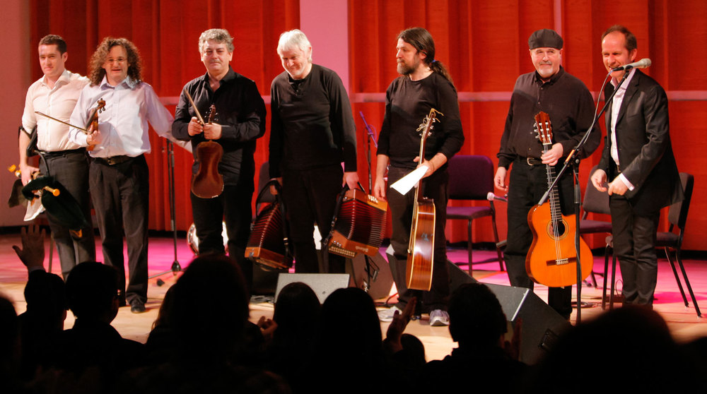 left to right: David Power, Martin Hayes, Cathal Hayden, Máirtín O'Connor, Seamie O'Dowd, Dennis Cahill, Iarla Ó Lionáird Photo credit: Erin Baiano