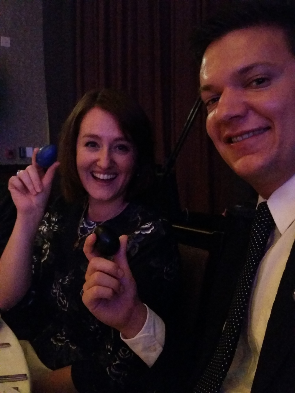 Sarah shakes an egg at the National Braille Press annual gala with FableVision Associate Producer, Michael Fogarasi.