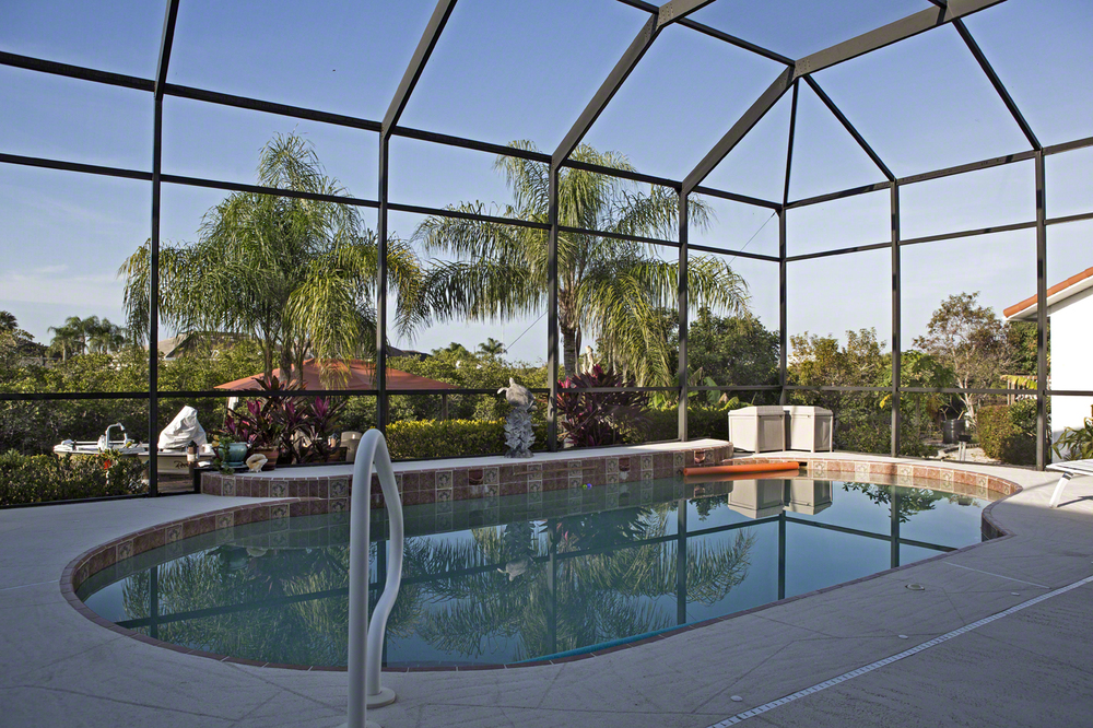 the screened in pool, which overlooks the canal.