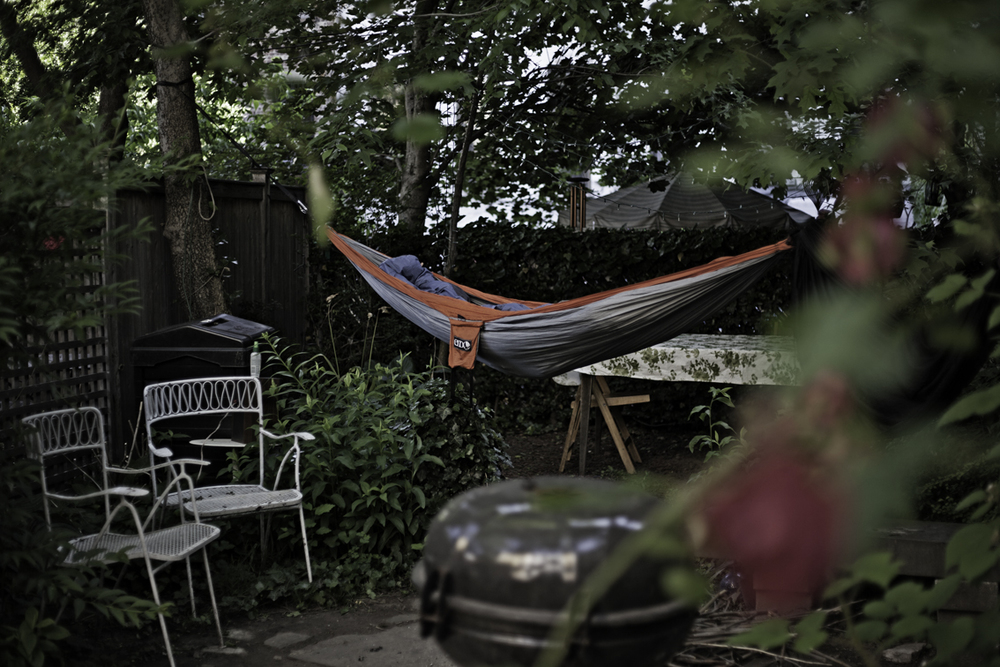 space was limited in the apartment, so i gladly volunteered to crash in the garden out back.  pretty sure this was my first urban hanging experience, and it was a surprisingly quiet back there