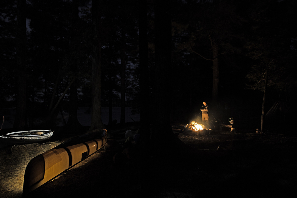 light painting fun - frank keeping warm by the fire at camp the first night of paddling.  buck island on upper saranac lake