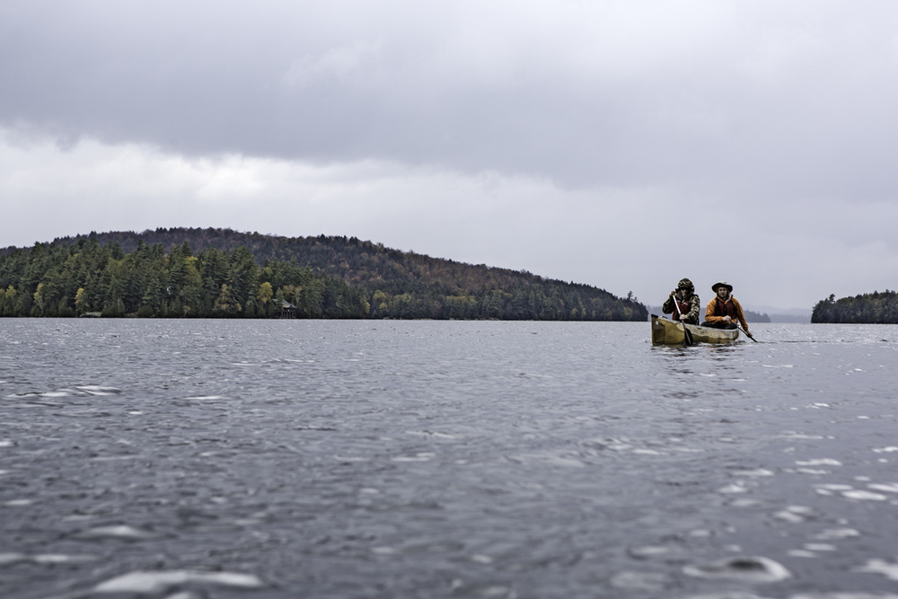 the gills pulling into the leeward side of deer island on upper saranac, after a windy, rainy mile of open water.  if it looks miserable, that's because it was.