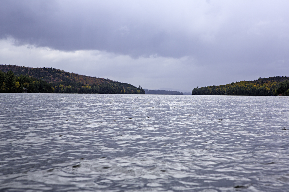 the rain that we just paddled through, on the narrows section of upper sarnac lake
