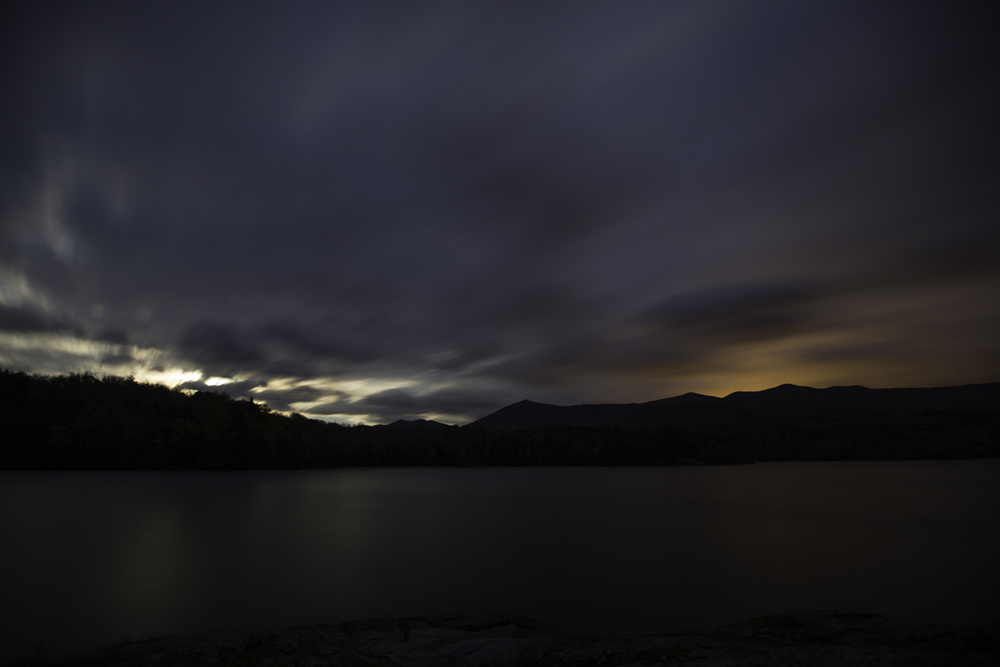 another view of the moon rise - light pollution from lake placid is reflected in the clouds