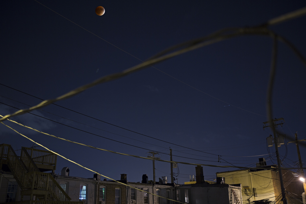 The total lunar eclipse on september 27th, as seen from our bathroom window in Baltimore, MD.