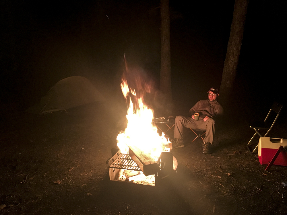 Loren enjoying some booze and a warm fire after getting the car stuck but before the shit really hit the fan.  So peaceful.