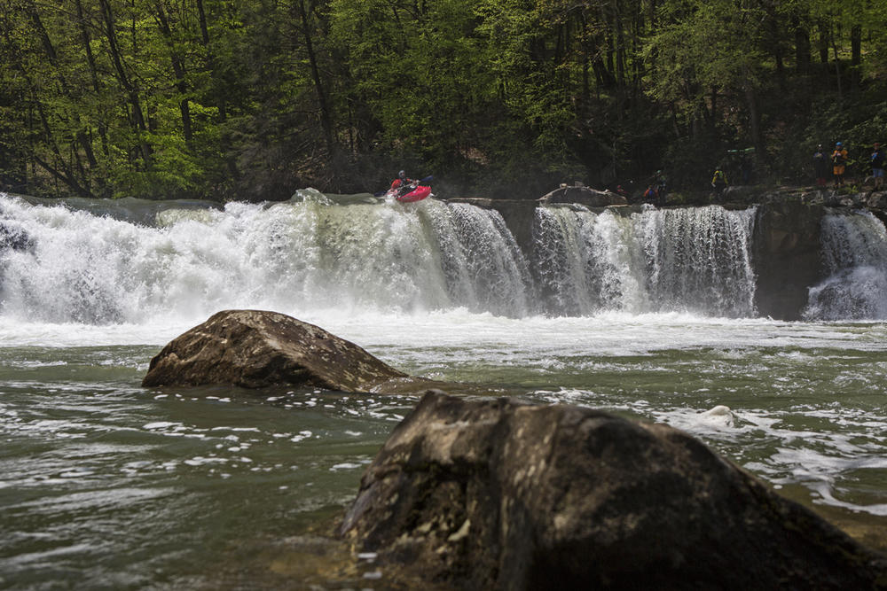 Jim launching off the top of 18 foot Wonder Falls on the LBS, class IV.