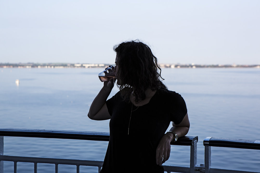 Sloane enjoying some wine while cruising up the Swedish coast.